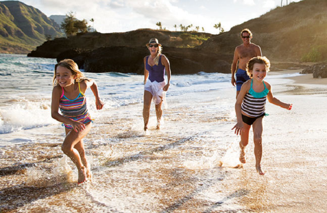 family playing at kauai beach resort